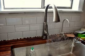 how to do a tile backsplash in kitchen how to add a tile backsplash in the kitchen the duckling house