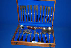 a six setting brass cutlery set with wood inlay
