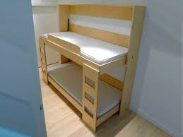Folding Bed For Kid Dumbo Tuck Bed Packs Two Folding Beds Into One Wall Unit
