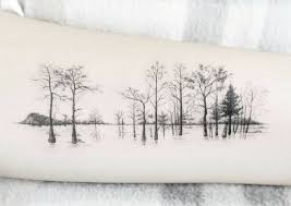 arm of trees with one color tatoo arm