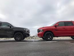 nissan titan vs dodge ram badass trucks in detroit 2017 chevrolet suburban z71 midnight