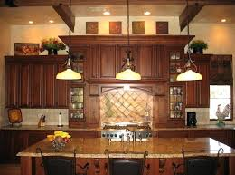 christmas decorations for kitchen cabinets above the cabinet decorating ideas how to decorate above kitchen