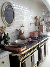 rustic kitchen style with round chalkboard and subway tiles