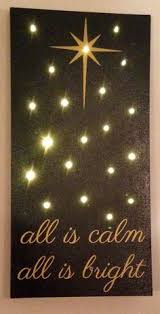 this hand painted all is calm all is bright sign with lighted