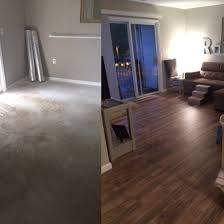 before and after floors in living room cement to laminate by