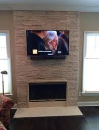 Tv Mount Over Fireplace by Tv Mounting Over A Limestone Fireplace Wall With Wires Concealed