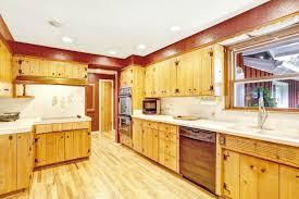 rustic kitchen with hardwood floors built in bookshelf in