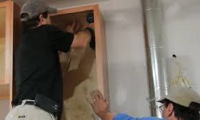 how to fix kitchen base cabinets to wall 6 tips for kitchen cabinet installation pro remodeler