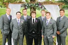 groomsmen attire for wedding fall wedding black tux for the groom grey suits for the