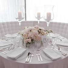 peonies on wedding tables and as wedding bouquet