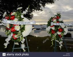 dedication wreaths overlook the uss arizona memorial prior to a u s