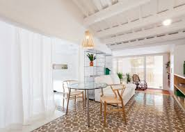 compact apartment opens up with restored tiled floors in barcelona