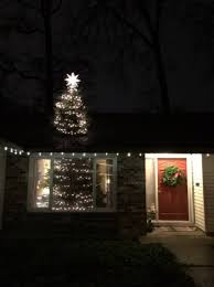 stick christmas tree with lights this couple bought a 20ft christmas tree and cut it in half so it