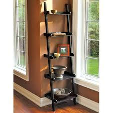 decorating black wooden leaning ladder shelf with 4 drawers for
