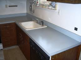 granite countertop ikea kitchen white cabinets butterfly gas