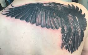 backpiece flying raven tattoo by herm