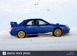 subaru winter subaru impreza 2 5 wrx sti model year 2005 blue moving side