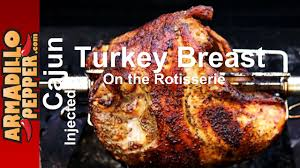turkey rotisserie cajun injected turkey breast on the rotisserie for thanksgiving