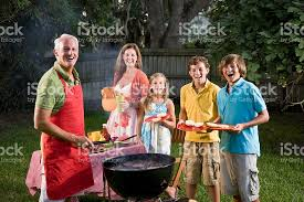 Backyard Barbeque Family Grilling Burgers On Backyard Barbecue Grill Stock Photo