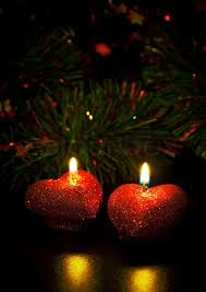 heart shaped christmas lights christmas card with two heart shaped candles stock photo colourbox