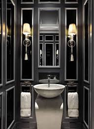 black masculine bathroom color ideas with wall sconces masculine