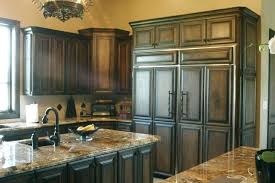 how do you stain kitchen cabinets stained wood kitchen cabinets brown cabinets white counter staining