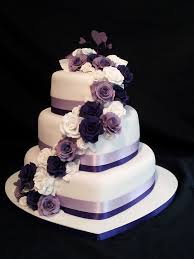heart wedding cake 3 tier heart shaped wedding cake roses cascading with a