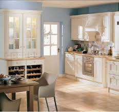 kitchen design trends soft blue wall color with classic white cabinet for country
