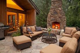 outdoor patio stone deck with plantation futniture and meval stone fireplace