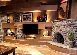 stacked stone corner fireplace design for an upscale custom home entertainment center a wall design by