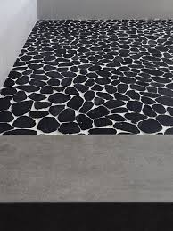 black white sliced pebble tile floor modern bathroom