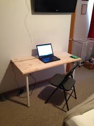 wall mounted computer desk made of wooden in white finished