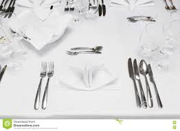 restaurant table with cutlery and glasses stock photo image