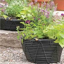 diy self watering garden hose pot gardening mother earth living