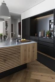 stainless steel kitchen island on unfinished wooden cabinet black