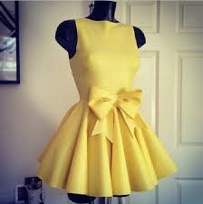 yellow dress with bow in front on the hunt