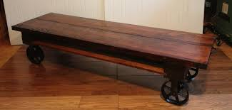 Wooden Coffee Table With Wheels by Tripod Wooden Coffee Table With Wheels On Laminate Floor Elegant