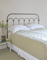 bedroom design dark wrought iron headboard with smooth beige