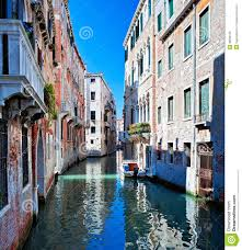 colored venice canal with houses in water stock photo image