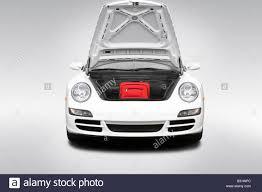 porsche carrera 2008 2008 porsche 911 carrera 4s in white trunk props stock photo