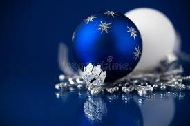 silver white and blue ornaments on blue background