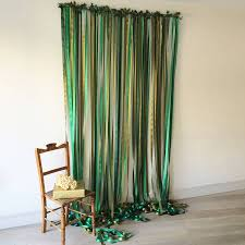 wedding backdrop green green ribbon backdrop on covered pole by just add a dress