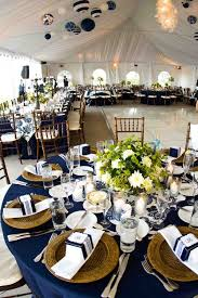 navy blue table linens navy blue tablecloths wooden chargers and a hint of green