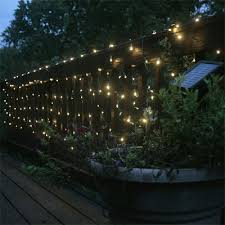 Solar Lights Patio by Led Solar Lights On Fence Makes A Garden Looks Oh So Magical
