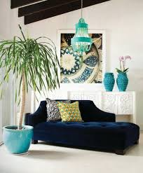 royal blue chaise lounge turquoise accents and peacock pillow