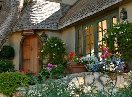 fascinating small house architecture with round flower garden and