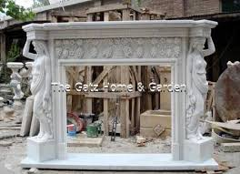 marble fireplace mantel and surround featuring figural carvings