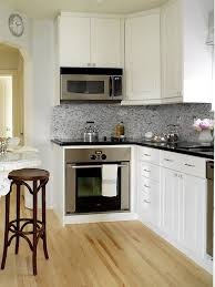 Small Kitchen White Cabinets Black Granite Countertops With White Cabinets Outofhome