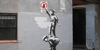 banksy mural appears in new york is swiftly vandalized huffpost
