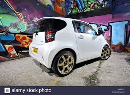 modified toyota modified toyota iq sub compact city car and graffiti wall stock
